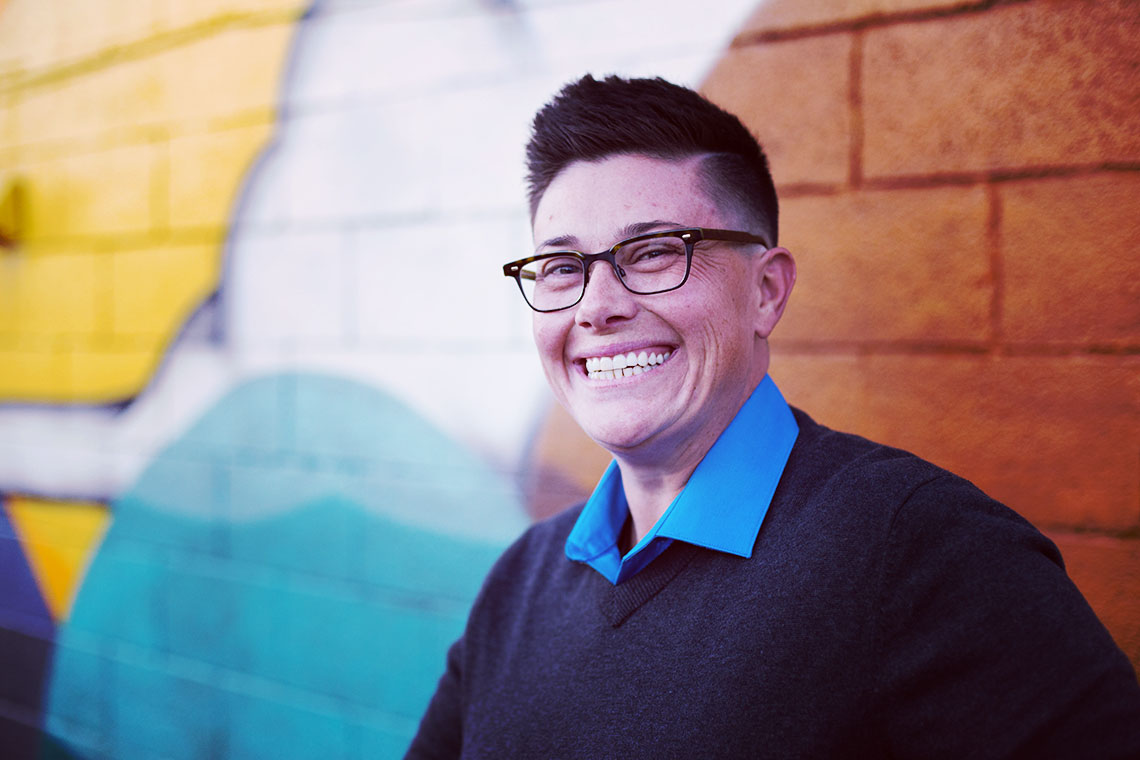 LGBTQ therapist Asher Eno smiling in Denver